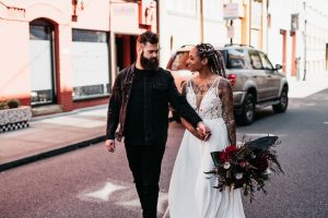 A line beaded wedding gown with slit and red flowers